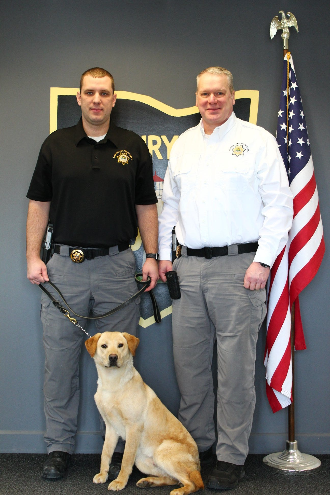 Chief Michael Meisler, right, of the Danbury Township Police Department, said Officer Brian Sloan's K-9 partner, Kalahan, will be trained in tracking nonviolent offenders in the future.