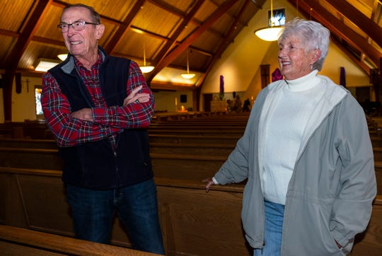 Ted Krause, left, and Diane Busuttil speak after mass at St. Catherine's Catholic Church Tuesday, April 16, 2019 in Algonac.