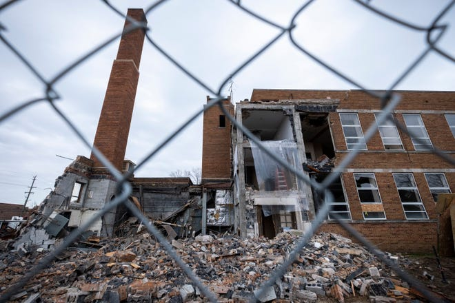 Crews work to demolish St. Catherine's  School Tuesday, April 16, 2019 in Algonac.