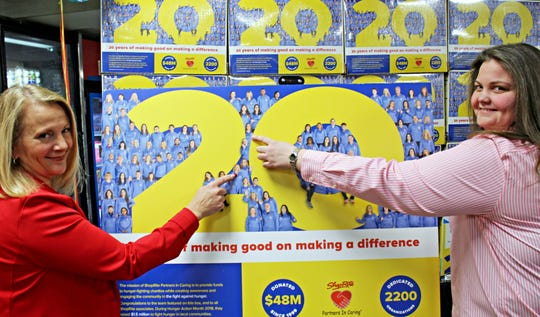 Maggie Zingaro, of Pleasant Valley, left to right, and Anna Mahone, of Fishkill, both ShopRite store associates, point to their photos on the back of the limited-edition Cherrios boxes at ShopRite of Carmel, Putnam County.
