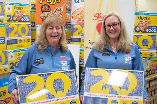 Rosemarie Duffy of Kingston, left, and Sherry Conklin of Highland, old up their customized Cherrios boxes where they work at ShopRite of New Paltz.
