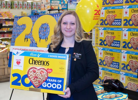 Kayla Taylor of Wappingers Falls, who works at ShopRite of Fishkill, is one of 101 ShopRite associates whose photo is on the back of the special Cheerios boxes.
