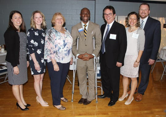 Penn State Mont Alto Chancellor Francis K. Achampong (center) with the Ross family (from left): Alyssa Ross, Tracy Ross, Donna Ross, Mike Ross, Kira Coy, and Bill Coy.