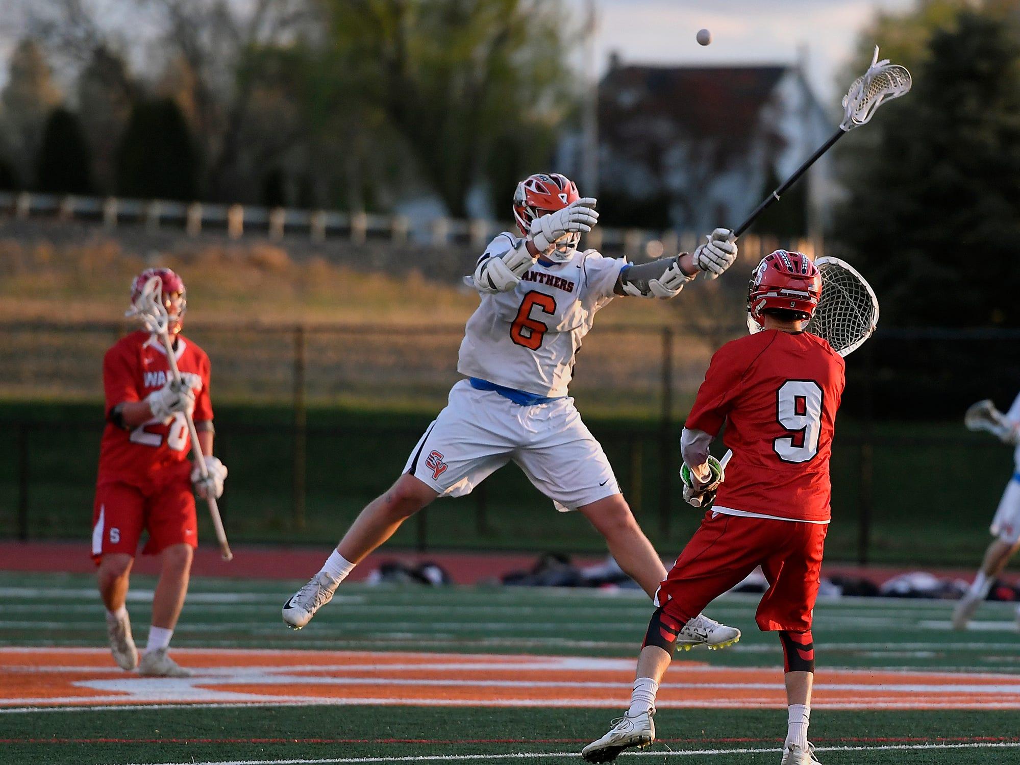 Ryan Kilgour of Central York makes a leaping attempt to block a pass by Connor Kernan of Susquehannock, Monday, April 15, 2019.John A. Pavoncello photo
