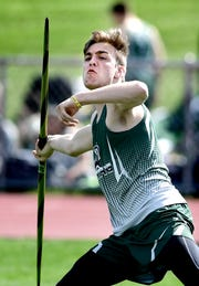 """York County School of Technology's Hunter Karpulk makes a throw during a home meet against Littlestown Tuesday, April 16, 2019. He finished first with a throw of 133' 6"""". Bill Kalina photo"""