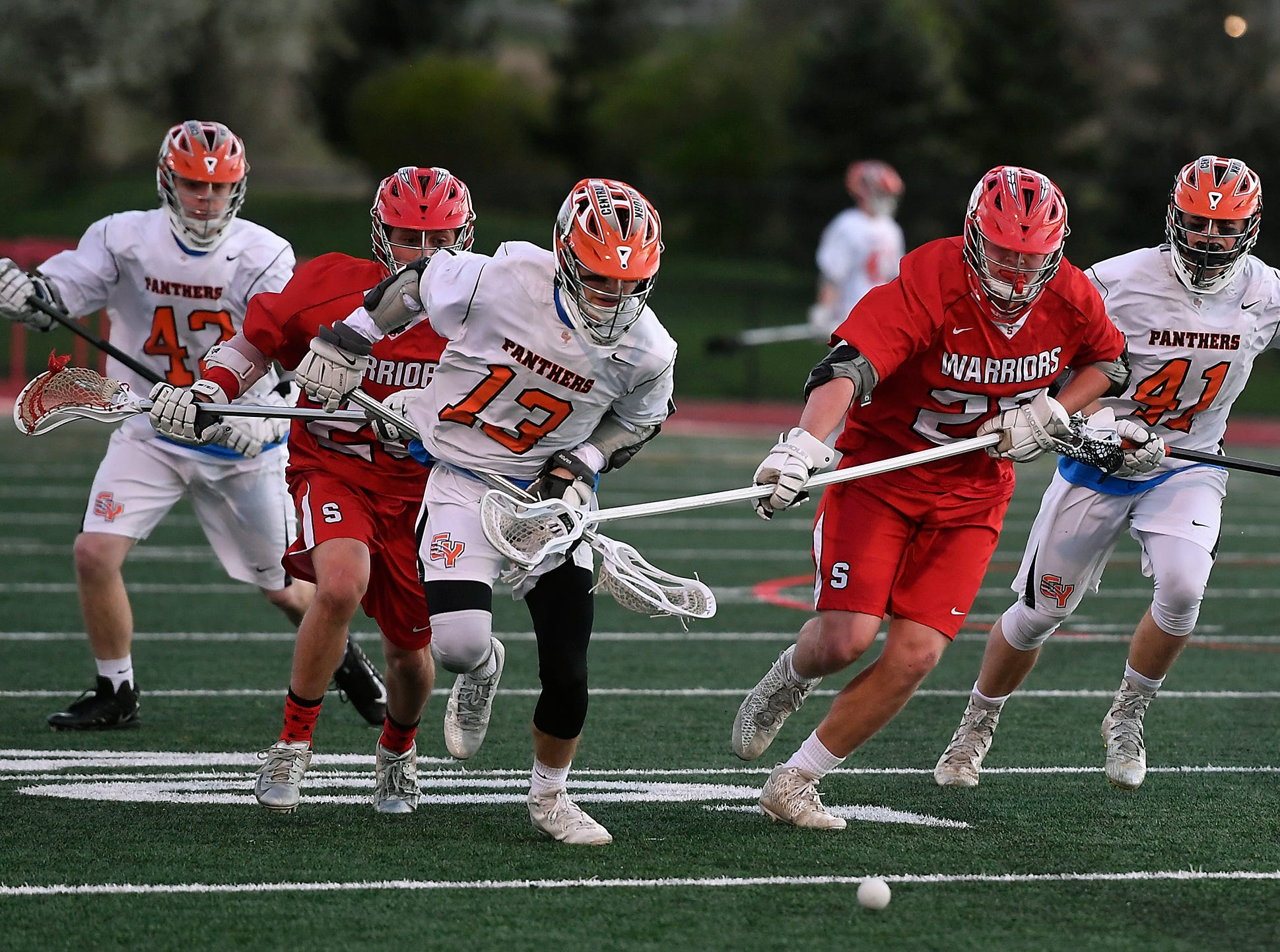 Logan Pauluch of Central York (13) and Susquehannock's Daniel Clapp chase down a loose ball, Monday, April 15, 2019.John A. Pavoncello photo