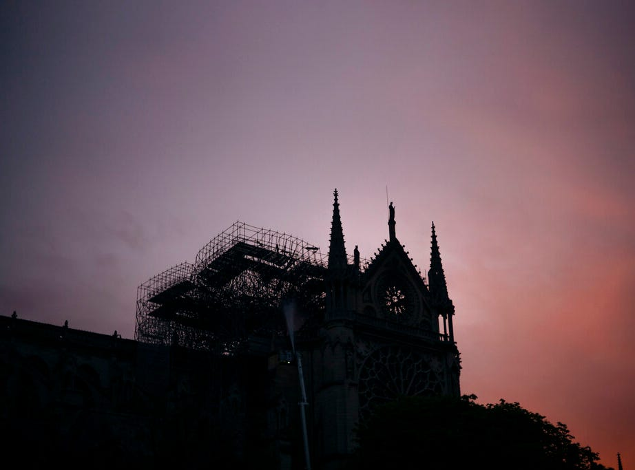 The Notre Dame cathedral is seen on sunrise after the fire in Paris, Tuesday, April 16, 2019. A catastrophic fire engulfed the upper reaches of Paris' soaring Notre Dame Cathedral as it was undergoing renovations Monday, threatening one of the greatest architectural treasures of the Western world as tourists and Parisians looked on aghast from the streets below. (AP Photo/Kamil Zihnioglu)