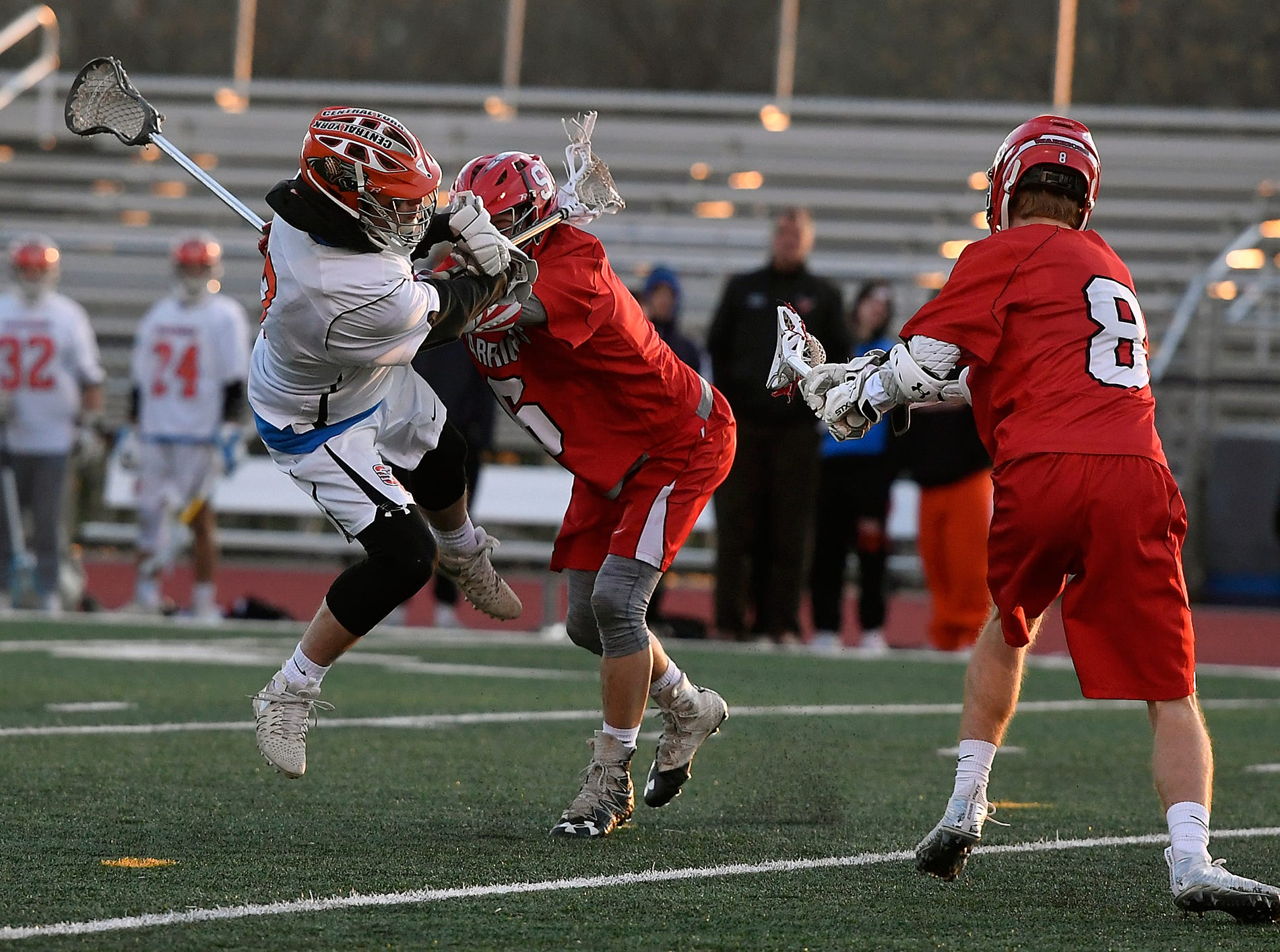 Matt Hawskworth of Central York is knocked off his feet by Ben Wilson of Susquehannock as he takes a shot on goal, Monday, April 15, 2019.John A. Pavoncello photo