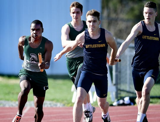 York County School of Technology's Jaiere Alford, left, takes the baton from teammate Gage Weaver while Littlestown's Brandon Staub, right, passes to Derek Herr during the final leg of the 400-meter relay at York Tech Tuesday, April 16, 2019. Tech won the relay. Bill Kalina photo