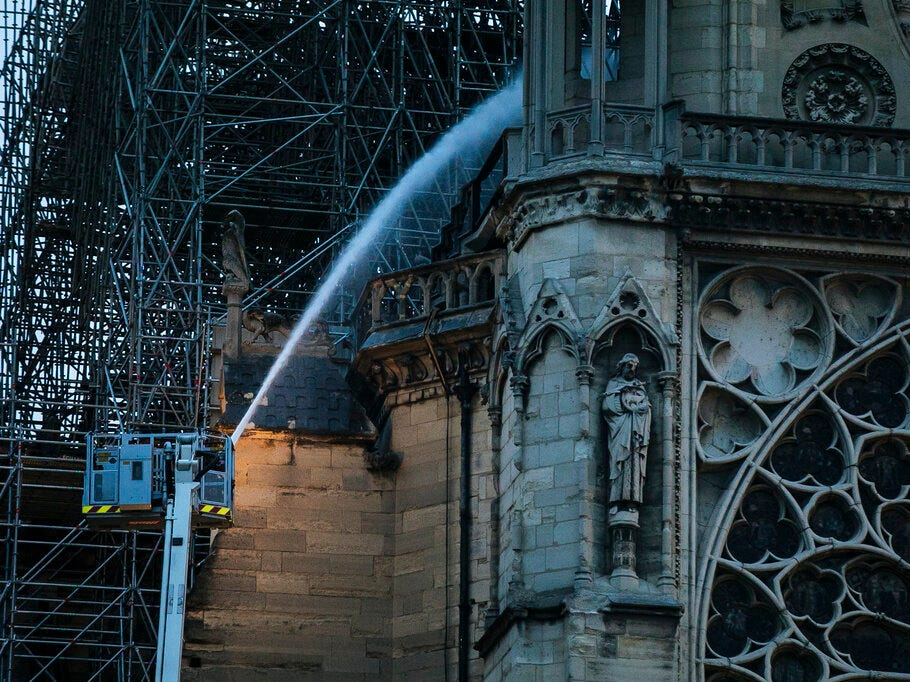 Firefighters operate on the Notre Dame cathedral after the fire in Paris, Tuesday, April 16, 2019. A catastrophic fire engulfed the upper reaches of Paris' soaring Notre Dame Cathedral as it was undergoing renovations Monday, threatening one of the greatest architectural treasures of the Western world as tourists and Parisians looked on aghast from the streets below. (AP Photo/Kamil Zihnioglu)