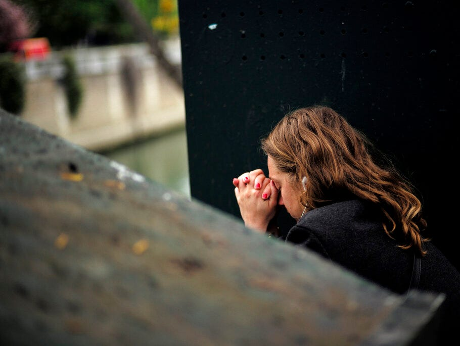 A woman sits in despair near the Notre Dame cathedral after the fire in Paris, Tuesday, April 16, 2019. A catastrophic fire engulfed the upper reaches of Paris' soaring Notre Dame Cathedral as it was undergoing renovations Monday, threatening one of the greatest architectural treasures of the Western world as tourists and Parisians looked on aghast from the streets below. (AP Photo/Kamil Zihnioglu)