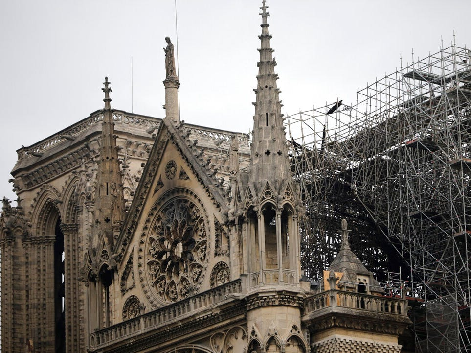 View of the Notre Dame cathedral after the fire in Paris, Tuesday, April 16, 2019. A catastrophic fire engulfed the upper reaches of Paris' soaring Notre Dame Cathedral as it was undergoing renovations Monday, threatening one of the greatest architectural treasures of the Western world as tourists and Parisians looked on aghast from the streets below. (AP Photo/Kamil Zihnioglu)