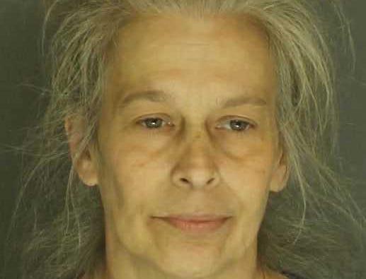 Karen Gustin, arrested for strangulation, simple assault and harassment.
