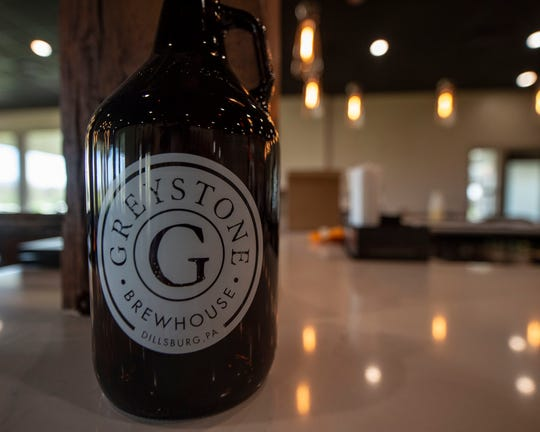 A growler from Greystone Brew House in Dillsburg. The brew house will release its 'Roundabout IPA' in April 2019. The restaurant opens to the public on Friday, April 19.
