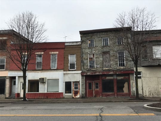 This block of Perry was an eyesore in 2017. The building to the left is now home to Ration Wine Bar, and the building on the right houses a pizza restaurant.