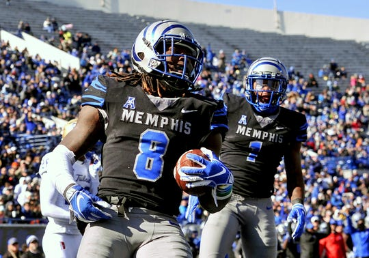 Memphis Tigers running back Darrell Henderson (8) celebrates after scoring a touchdown against Tulsa in the Liberty Bowl.