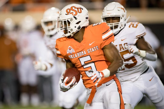 Oklahoma State Cowboys running back Justice Hill (5) runs the ball against Texas.