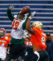 North safety Will Harris of Boston College (8) breaks up a pass intended for North tight end Donald Parham of Stetson (49) during practice for Saturday's Senior Bowl.