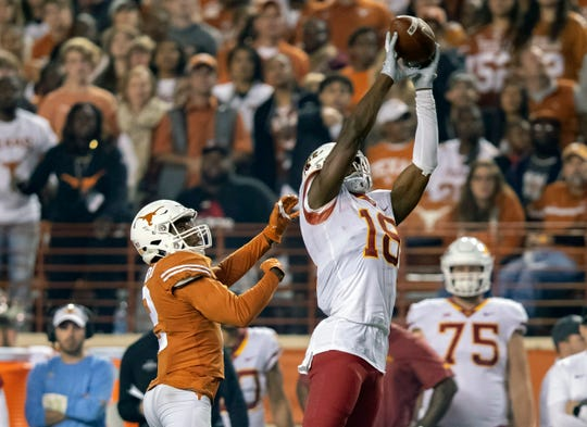 Iowa State Cyclones wide receiver Hakeem Butler (18) leaps to catch a pass against Texas.
