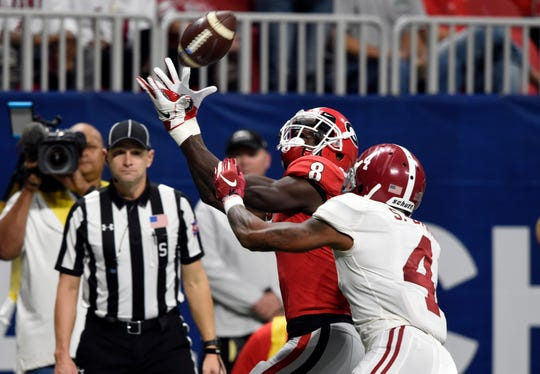 Georgia Bulldogs wide receiver Riley Ridley (8) makes a catch for a touchdown against Alabama.