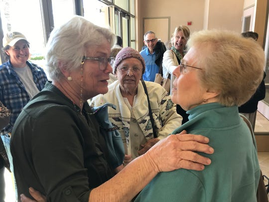 Pat Pell of Burney, left, and Carolyn Salini celebrate after the Shasta County Board of Supervisors agreed to go forward with a plan to purchase a new building for the Burney Library.