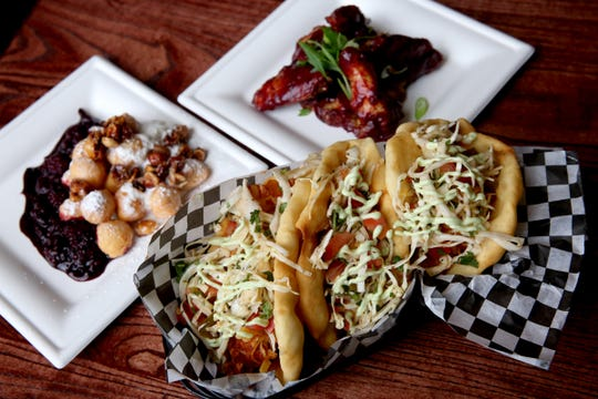 Indian fry bread chicken tacos, a dessert with Marionberries and candied hazelnuts and wings with a Marionberry chipotle barbecue sauce at Angel's Share Barrel House in Turner on April 16, 2019. The taphouse and restaurant inside a church built in 1891 is scheduled to open in May.