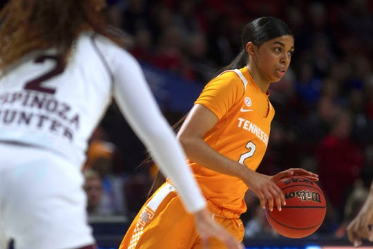 Tennessee Lady Volunteers guard Evina Westbrook (2) on a fast break while being defended by Mississippi State Bulldogs guard Andra Espinoza-Hunter (2) during the first half of game seven in the women's SEC Conference Tournament.