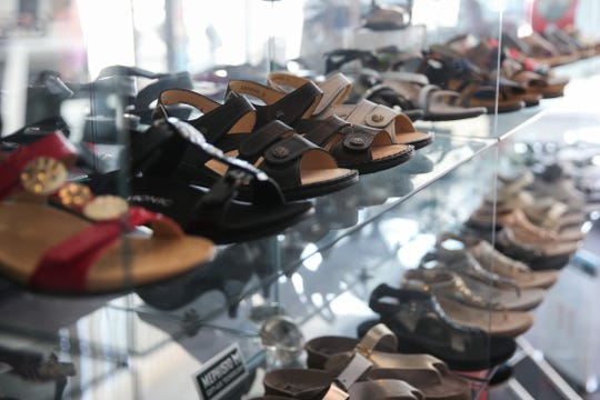 Shoes on display for sale at Heavenly Shoes Boutique, 43 W. Twohig Ave.