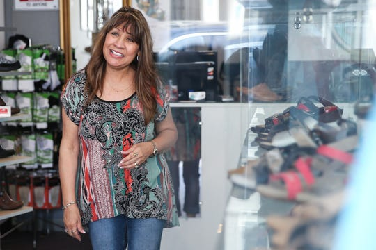 Mary Perkins greets a customer Friday, April 5, 2019, at Heavenly Shoes Boutique, 43 W. Twohig Ave.