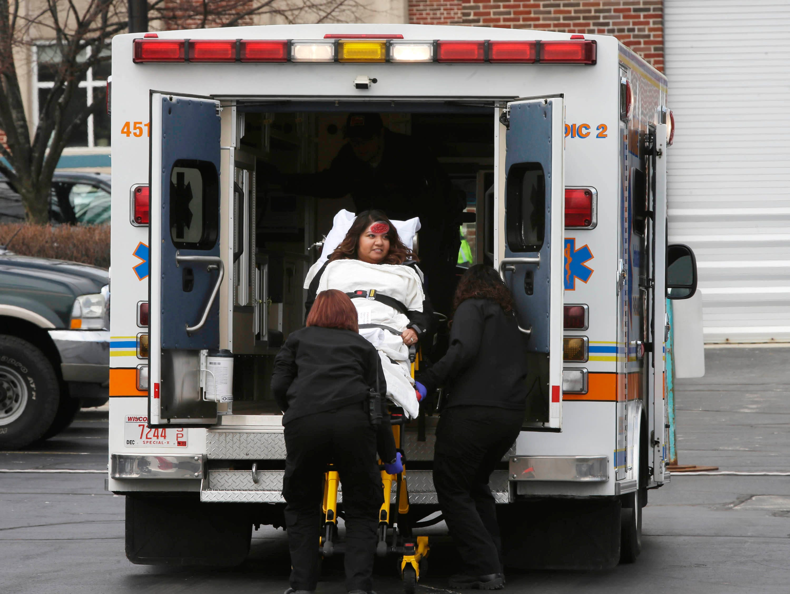 DRILL EXERCISE: A victim is loaded into an Orange Cross ambulance at Aurora Sheboygan Memorial Medical Center during a training exercise for Sheboygan area emergency agencies, Tuesday, April 16, 2019, in Sheboygan, Wis.