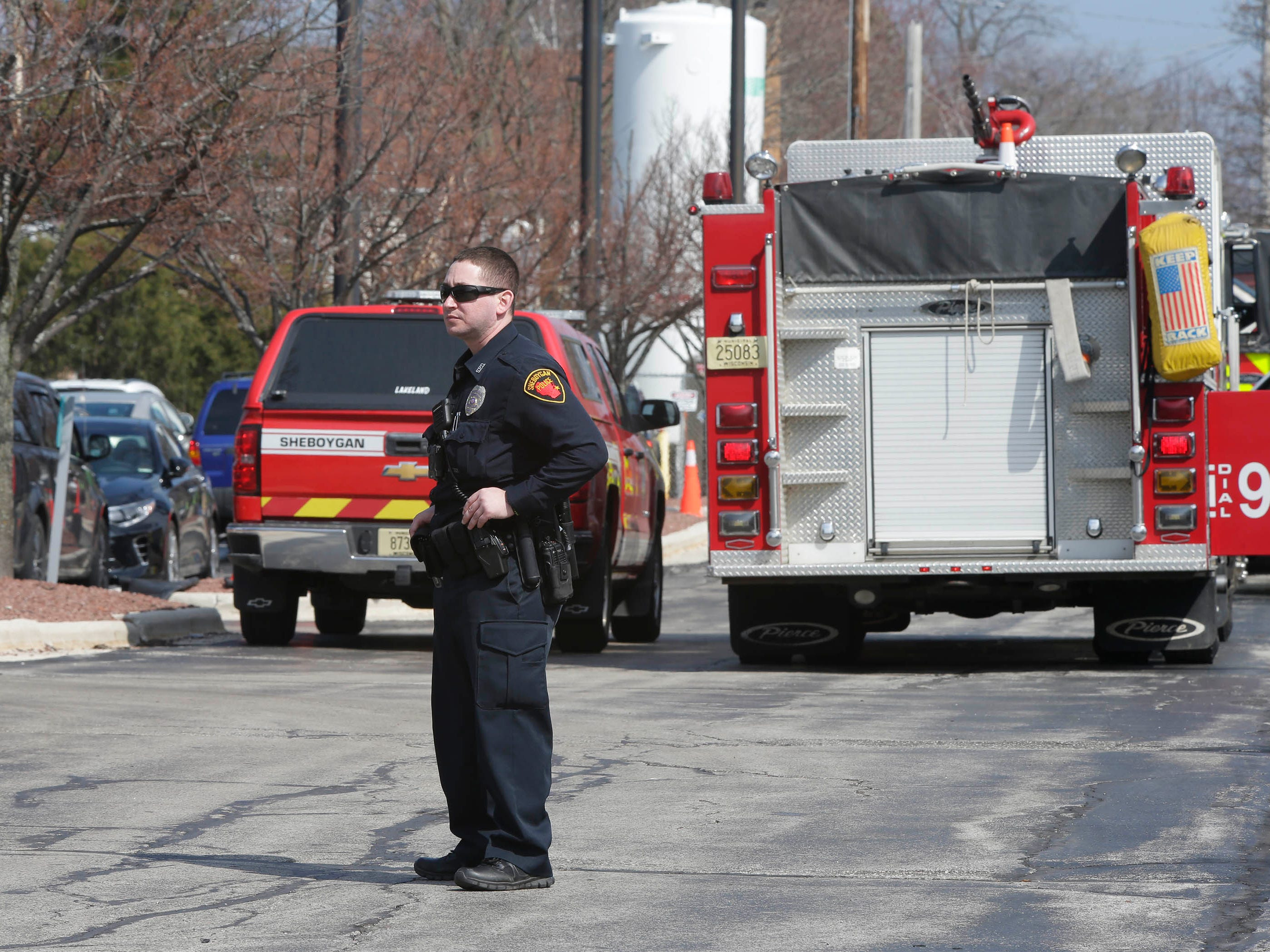 DRILL EXERCISE:  A Sheboygan Police officer stands at the perimeter of a training exercise for Sheboygan area emergency agencies, Tuesday, April 16, 2019, in Sheboygan, Wis.