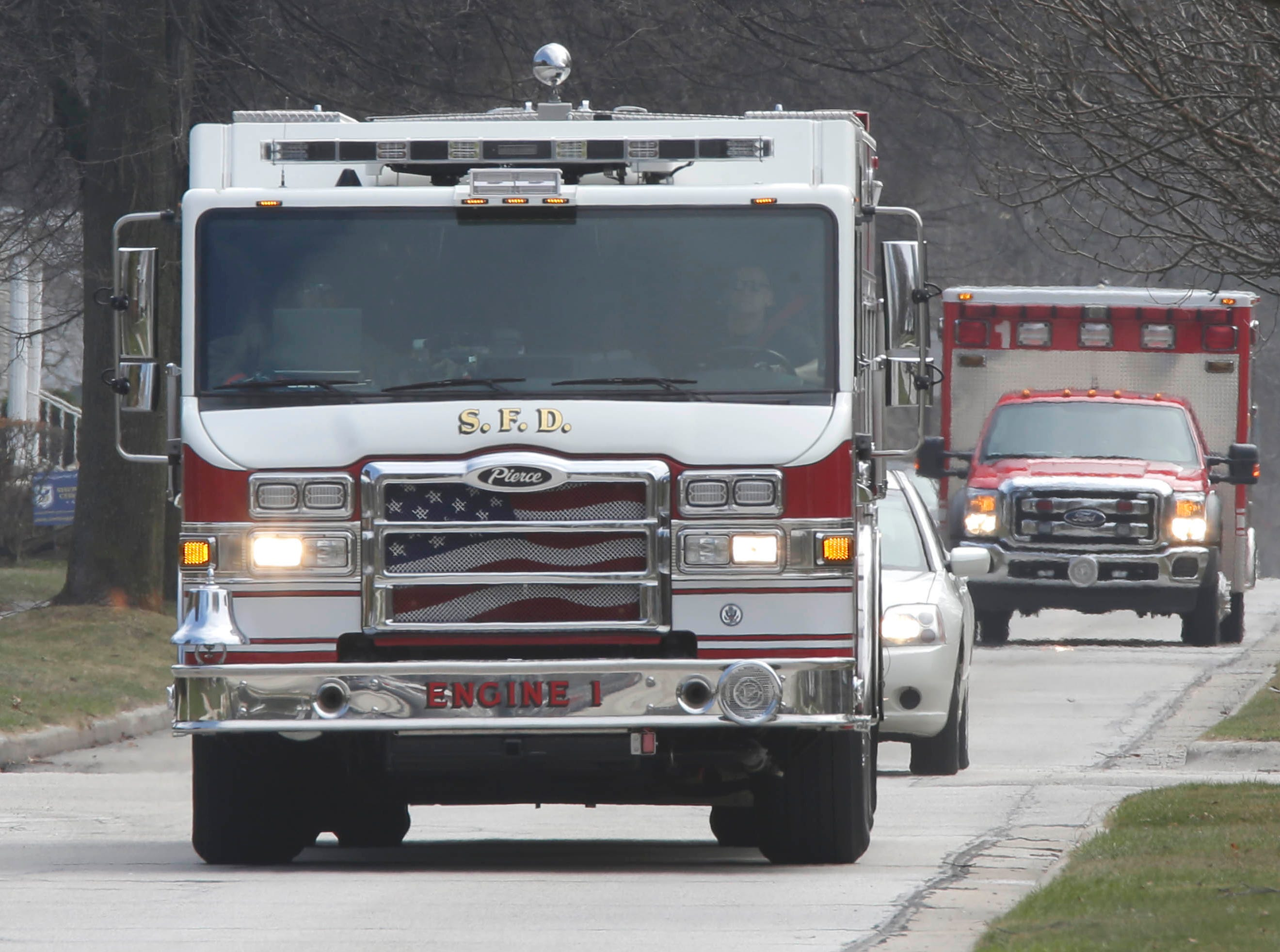 DRILL EXERCISE:  Sheboygan Fire vehicles travel down North 7th Street to group at Aurora Sheboygan Memorial Medical Center to take part in a drill for Sheboygan area emergency agencies, Tuesday, April 16, 2019, in Sheboygan, Wis.