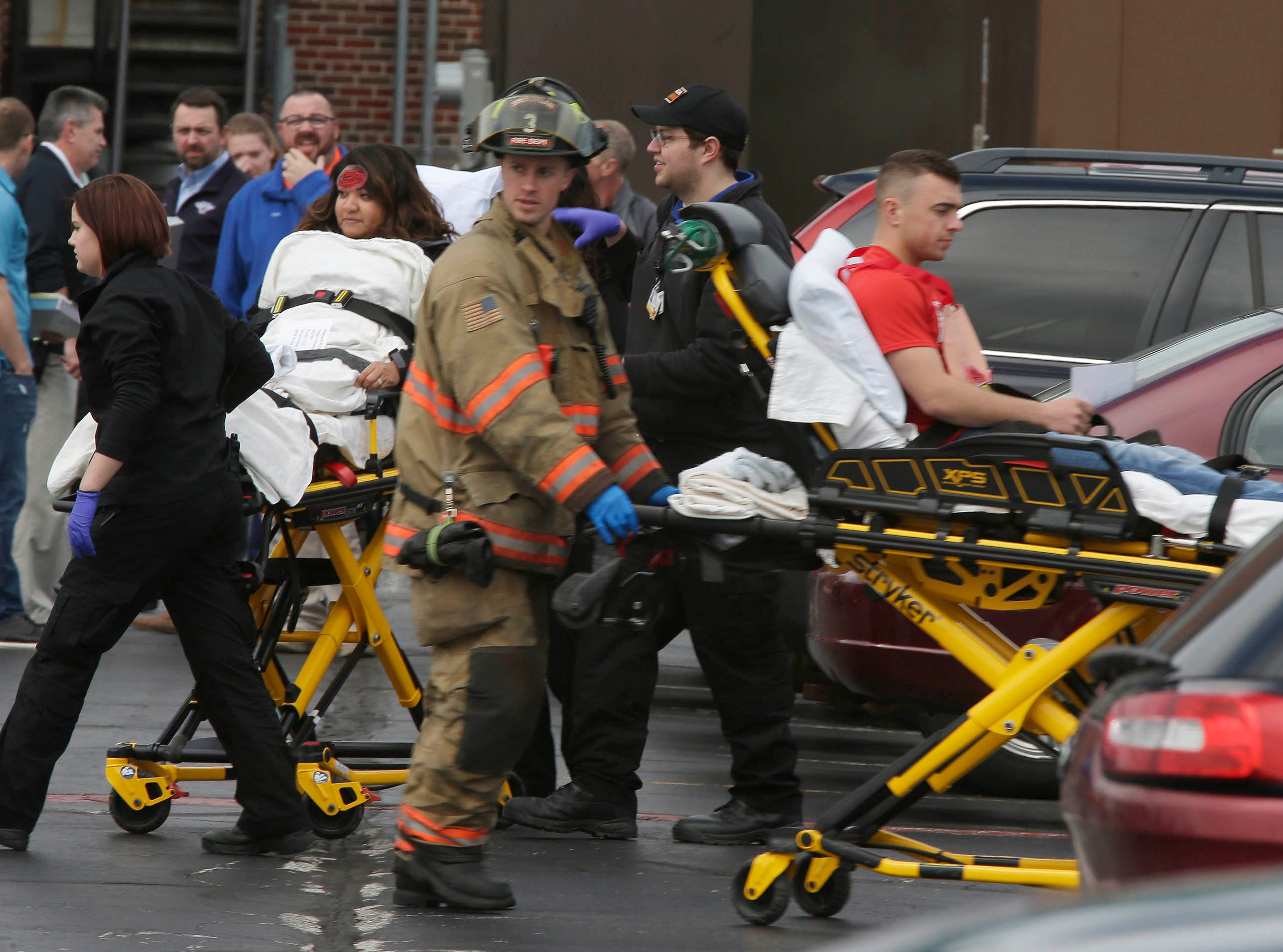 DRILL EXERCISE: Victims are moved to awaiting ambulances at Aurora Sheboygan Memorial Medical Center during a training exercise for Sheboygan area emergency agencies, Tuesday, April 16, 2019, in Sheboygan, Wis.