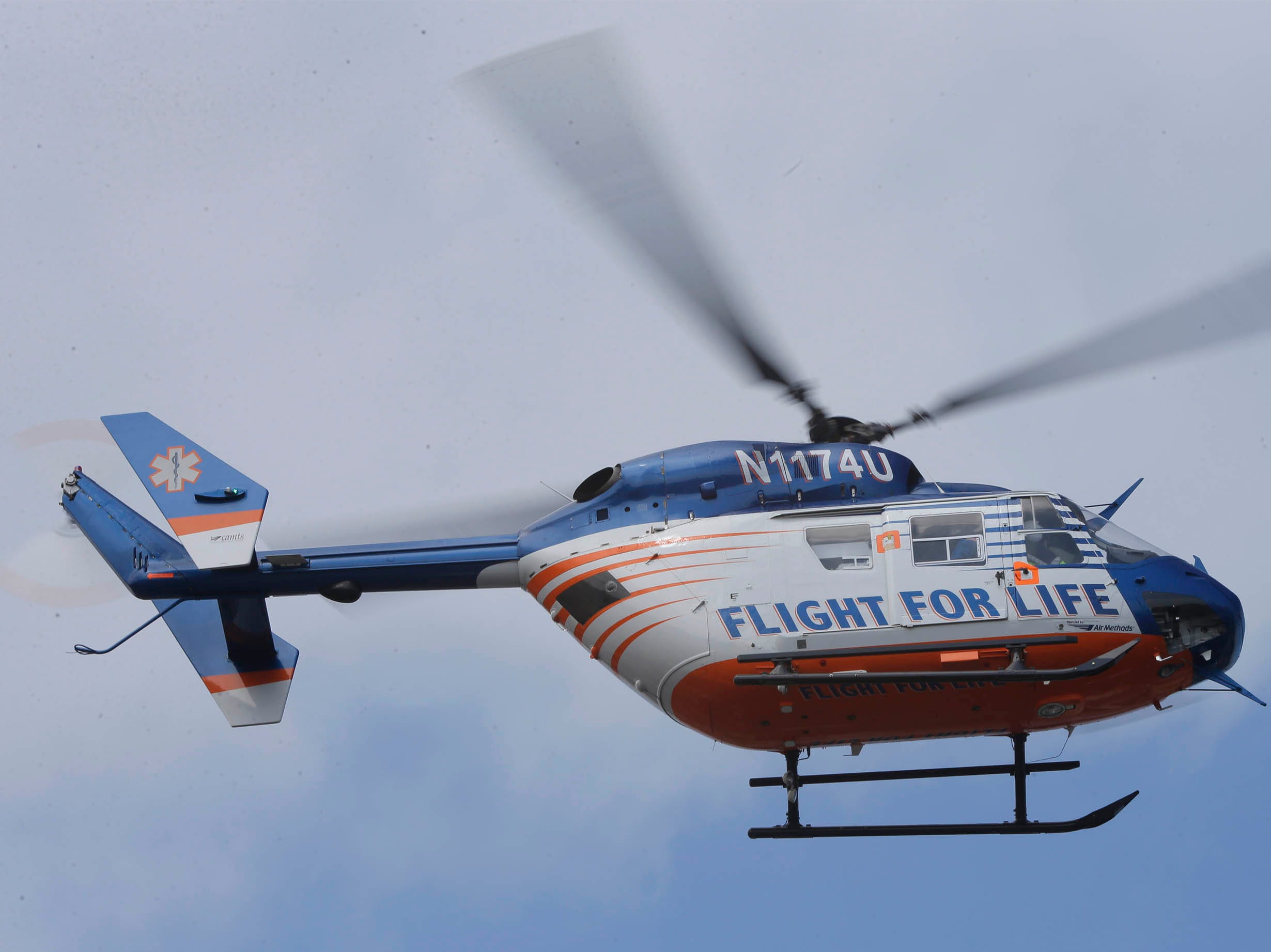 DRILL EXERCISE: A Flight For Life helicopter hovers over Aurora Sheboygan Memorial Medical Center,  Tuesday, April 16, 2019, in Sheboygan, Wis.