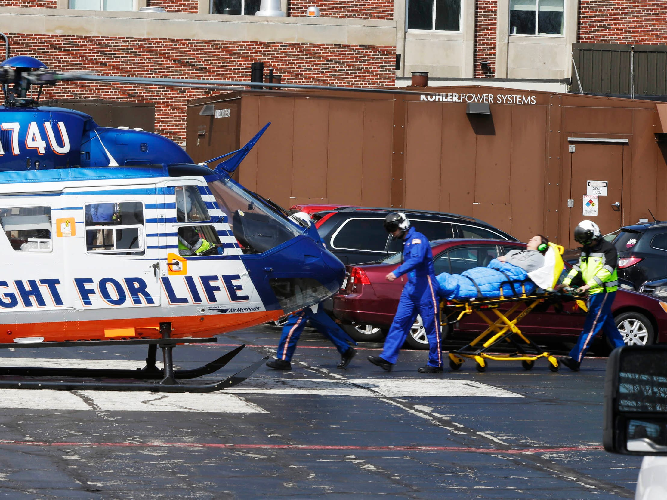 DRILL EXERCISE: A person portraying an injured person is rolled on a stretcher near an awaiting Flight For Life Helicopter at Aurora Sheboygan Memorial Medical Center during a training exercise for Sheboygan area emergency agencies, Tuesday, April 16, 2019, in Sheboygan, Wis.