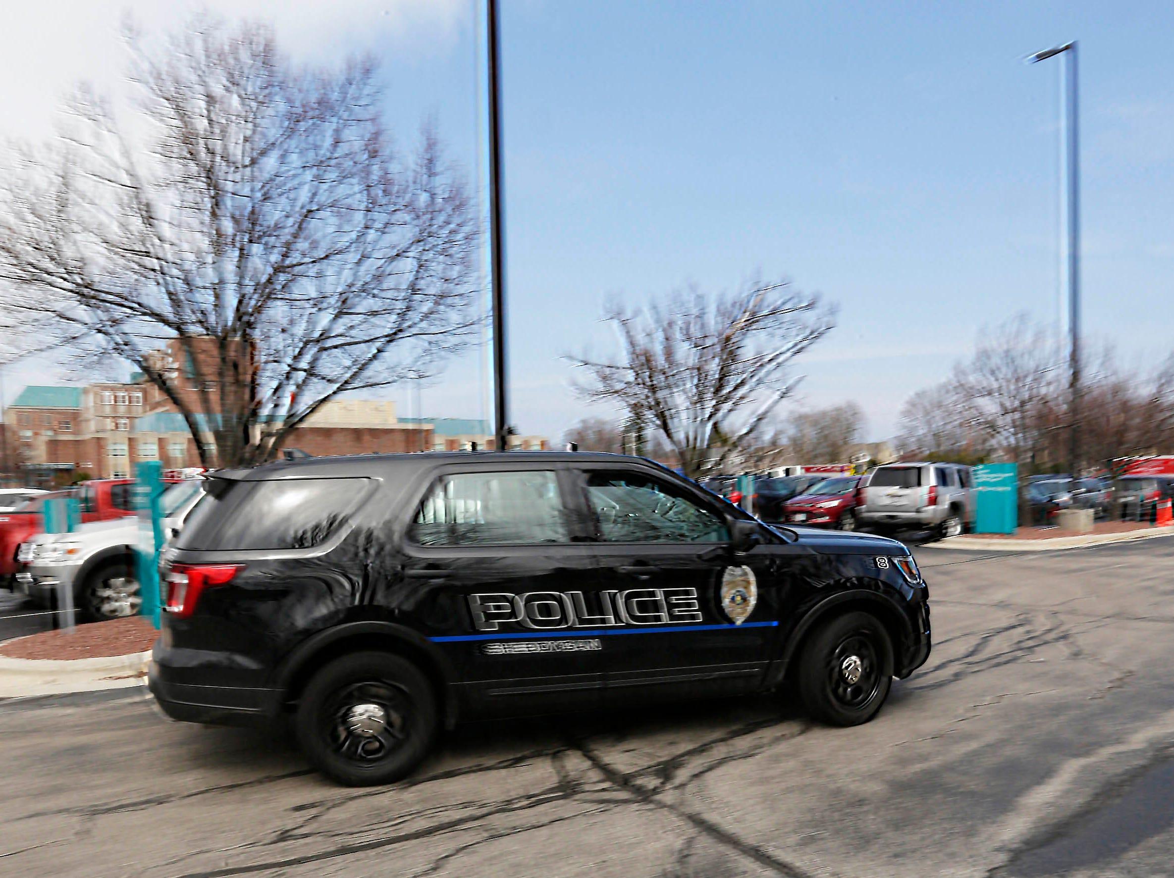 DRILL EXERCISE:  A Sheboygan Police car  drives to park at the training exercise for Sheboygan area emergency agencies, Tuesday, April 16, 2019, in Sheboygan, Wis.