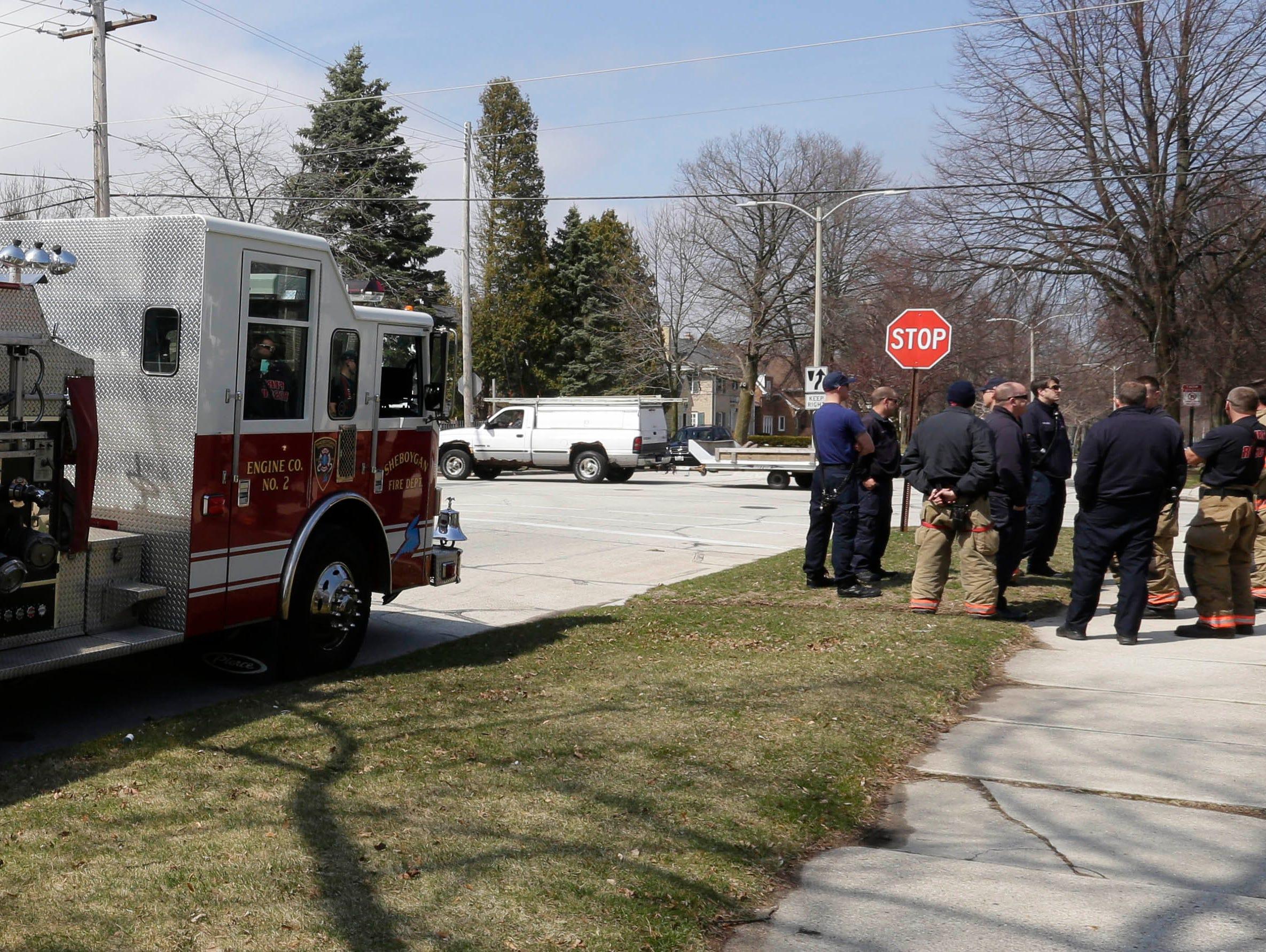 DRILL EXERCISE: Sheboygan firefighters group before a training exercise for Sheboygan area emergency agencies at Aurora Sheboygan Medical Center,Tuesday, April 16, 2019, in Sheboygan, Wis.