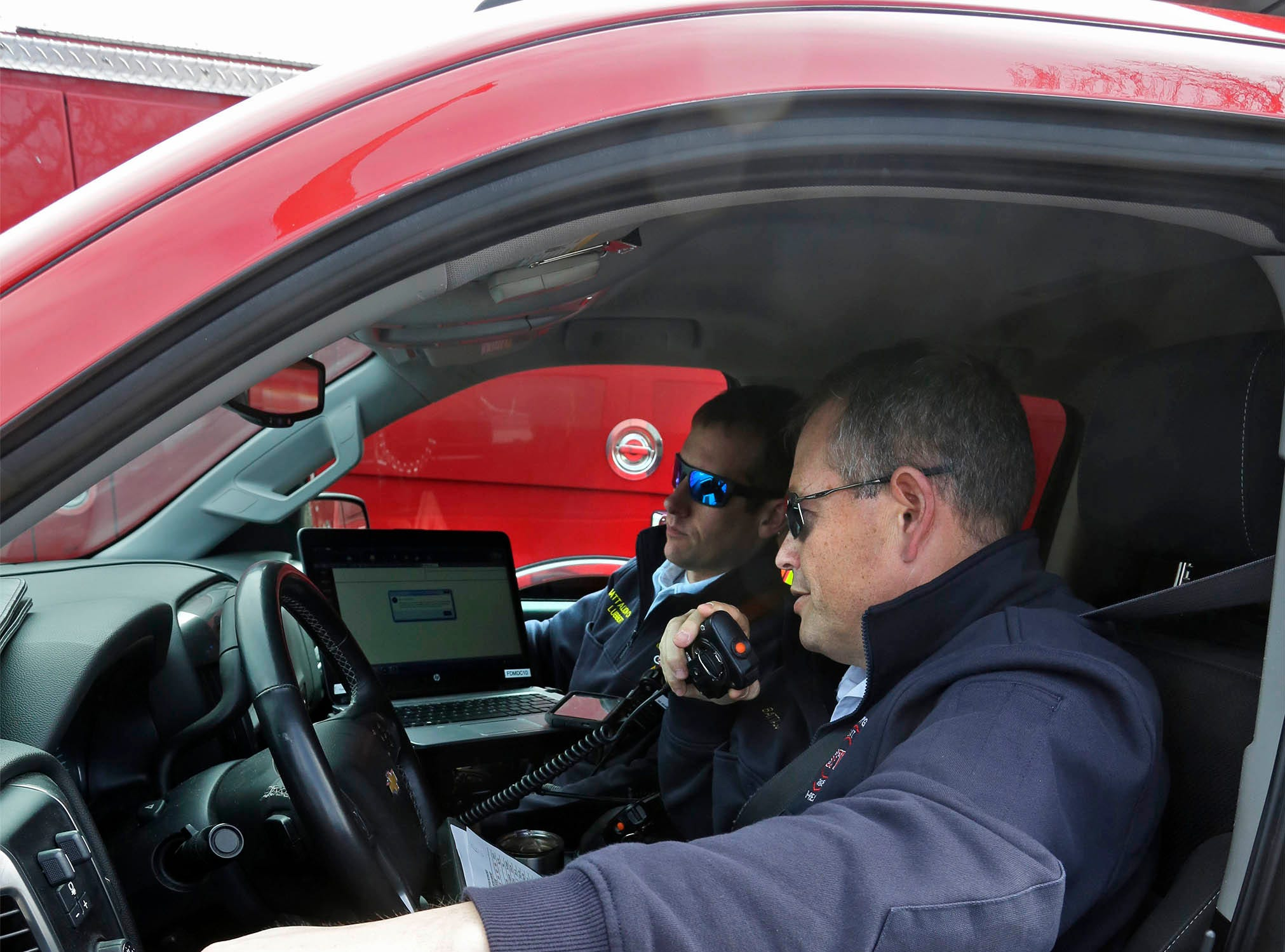 DRILL EXERCISE: Sheboygan Fire Department's Jeff Salzman, foreground and Mike Lubbert man the Incident Command vehicle during a drill at Aurora Sheboygan Memorial Medical Center, Tuesday, April 16, 2019, in Sheboygan, Wis.
