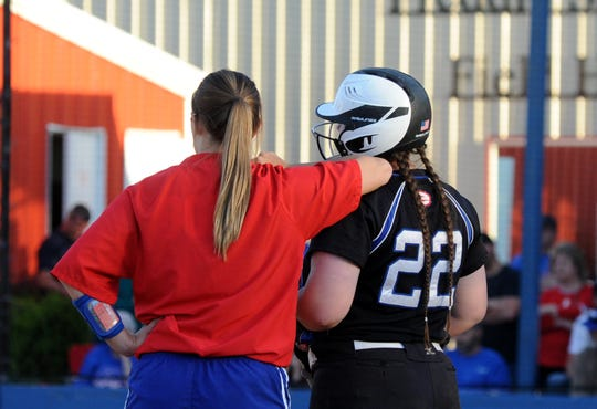 Baylee vs. Bayley; Evangel coach Baylee Shephard rests on the shoulder of Evangel slugger Bayley Mayo.