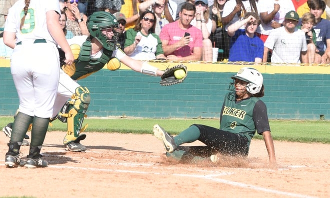 Captain Shreve catcher Emily Watts attempts a tag against a Walker runner in an LHSAA Class 5A state playoff game this past week.