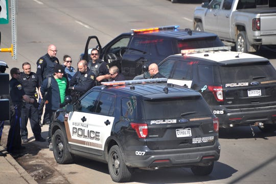 Police arrest a man for disorderly conduct on April 16.