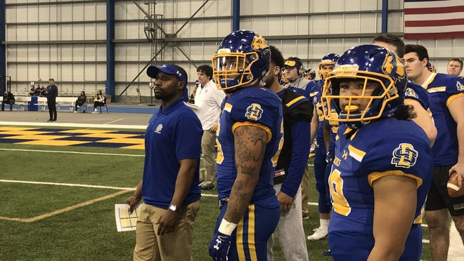 SDSU running backs coach Jimmy Beal (left) looks on during the Jacks spring football game Saturday at the S-JAC