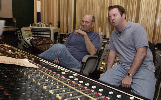 In this 2001 photo, Lou Whitney and Dale Wiley, president of Slewfoot Records, sit at the sound board at The Studio while recording a band playing at The Outland, a music venue next door in downtown Springfield.