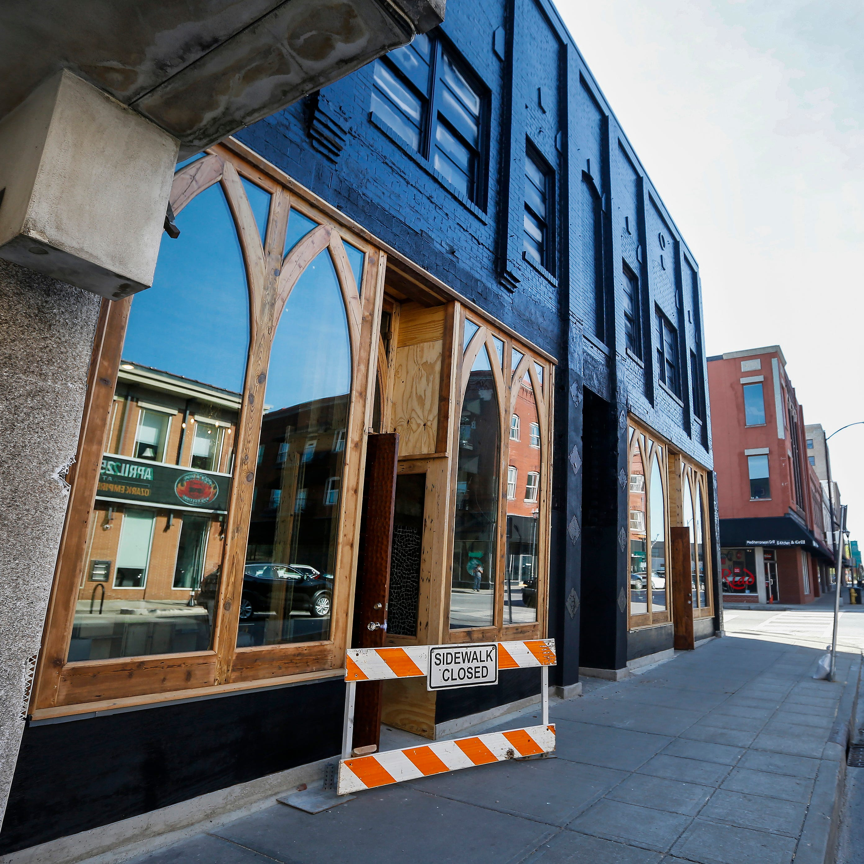 With Gothic windows and a glossy sheen, the former Lou Whitney Studio is transforming