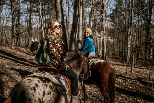 37 North Expeditions customers enjoy a scenic horseback ride before ending the day at a Branson winery.