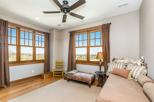 The home features an abundance of windows, taking full advantage of the Ozarks' beauty just outside.