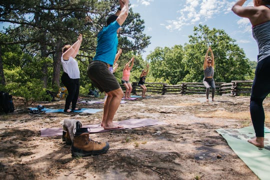 37 North Expeditions do yoga in an outdoors setting during a recent yoga hike and winery visit.