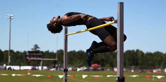 Lincoln senior Jaleel Howard high jumps at the District 3-3A track and field meet at Chiles on Monday, April 15, 2019.