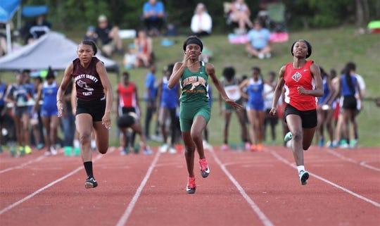 FAMU DRS senior Tashana Ligon runs the 100-meter dash next to NFC junior Alexsis Thomas during District 3-1A and 2-2A track and field meets at Florida High on Saturday, April 13, 2019.
