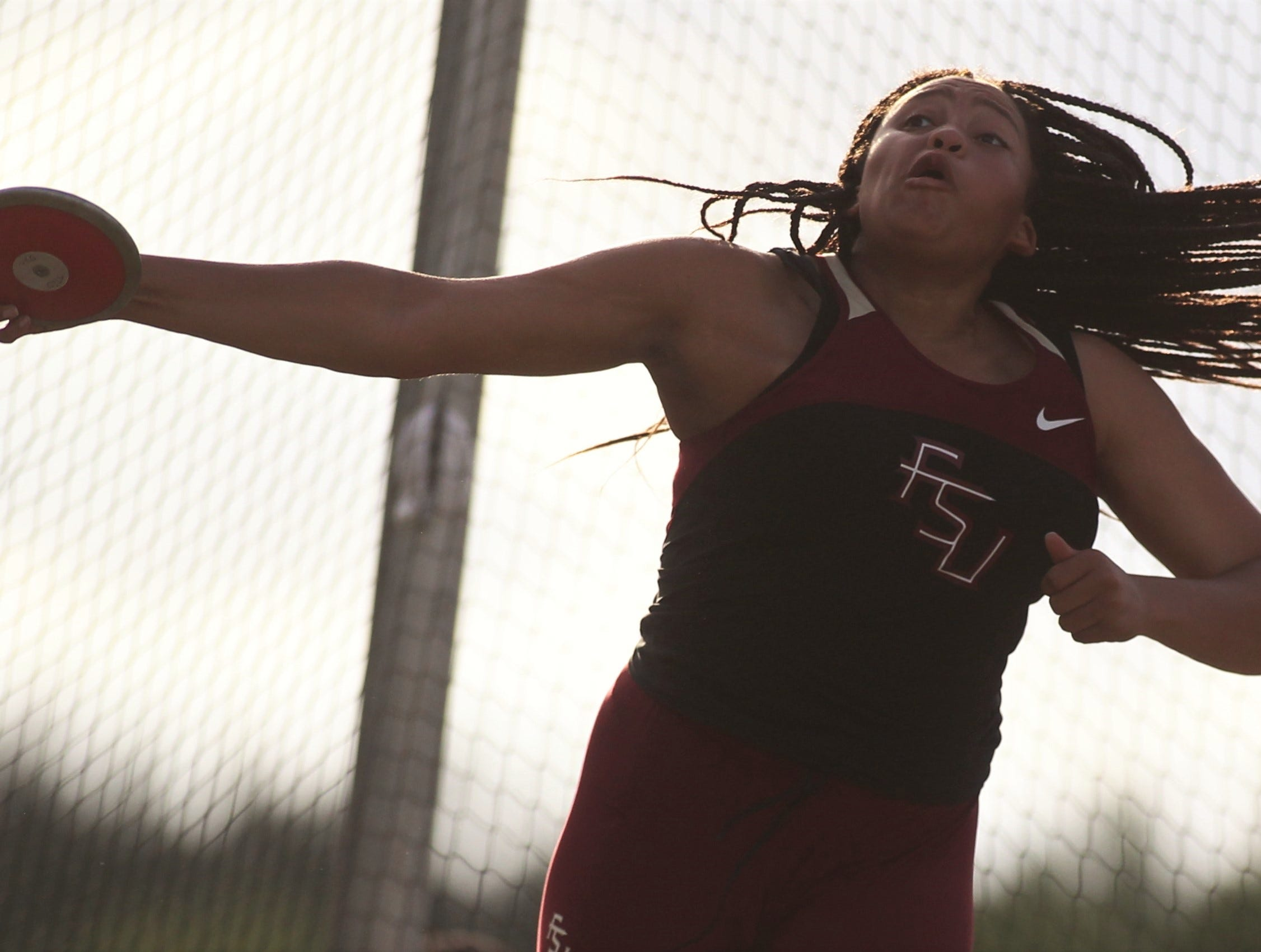 Florida High junior Jhordynn Stallworth throws discus during District 3-1A and 2-2A track and field meets at Florida High on Saturday, April 13, 2019.